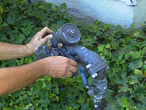San Bruno CA irrigation contractor inspects a backflow prevention device